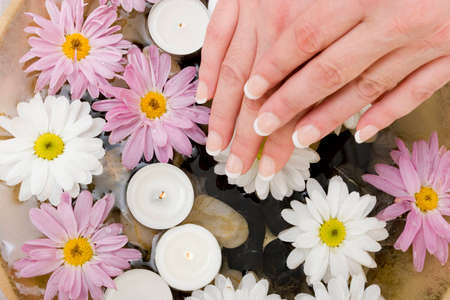 revitalize: Woman with French manicured hands