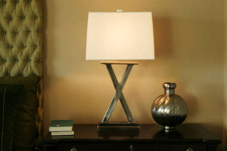 nightstand: Decorative nightlamp on nightstand