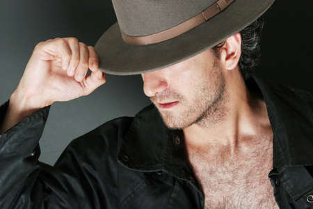 courteous: Portrait of a handsome man with hat