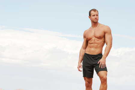 Athletic handsome man in shorts photo