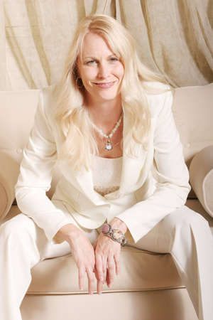 pantsuit: Smiling business woman in white suit