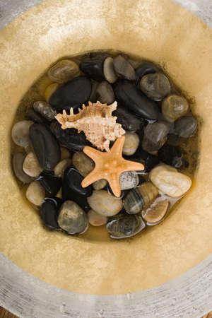 revitalize: Spa stones in water Stock Photo