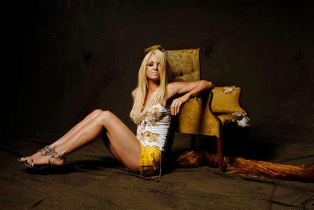 Sexy blond woman in mini skirt Stock Photo