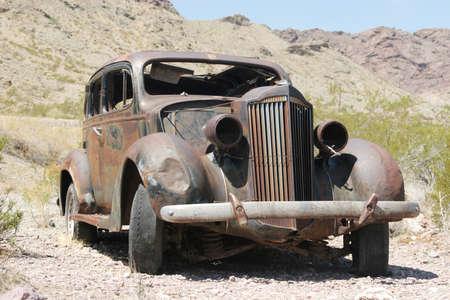 junk: Old rusty classic American car Stock Photo