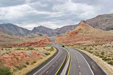 Desert highway curving through the landscape photo