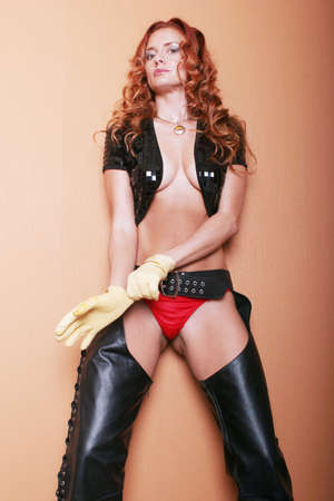 Sexy woman in black leather chaps Stock Photo - 1648263