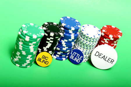 texas holdem: Poker chips and Texas holdem buttons Stock Photo