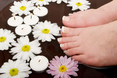 revitalize: Womans feet in bowl of water