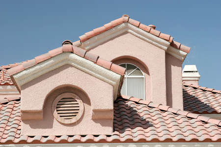 Roof detail of a stucco home Stock Photo