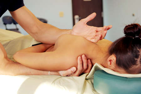 rejuvenate: Woman getting a massage Stock Photo