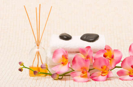 revitalize: Spa towels, oils and orchid Stock Photo