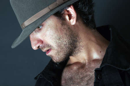 courtesy: Mysterious man in cowboy hat Stock Photo