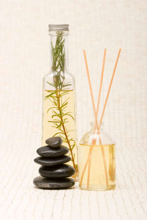 revitalize: Essential oils and massage stones Stock Photo