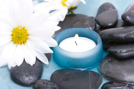 Spa stones, candle and daisy Stock Photo - 1684743