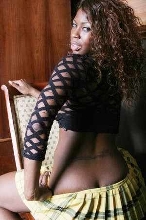 Beautiful black woman in mini skirt Stock Photo - 1684811