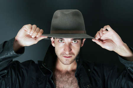courteous: Mysterious man in cowboy hat Stock Photo