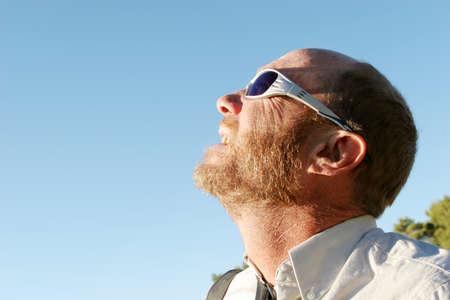 Man looking at the sun