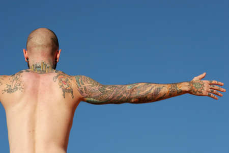 tattoo arm: Tattooed back of a man