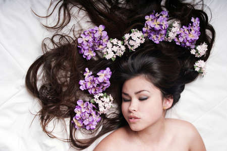 Beautiful woman with long hair sleeping