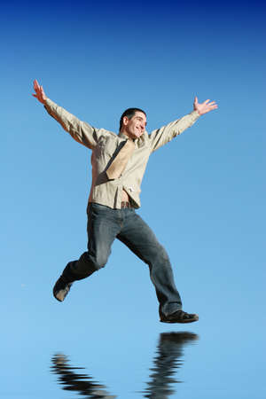 energy work: Ecstatic businessman jumping in the air Stock Photo