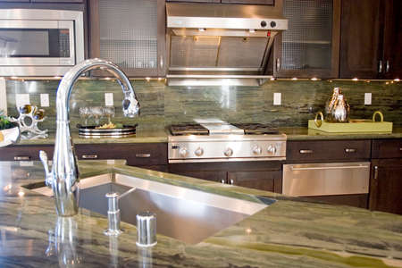 Modern kitchen with granite countertops photo
