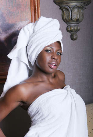 african american spa: Woman wrapped in towels at a dayspa Stock Photo