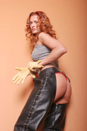 Sexy woman in black leather chaps Stock Photo - 1704176