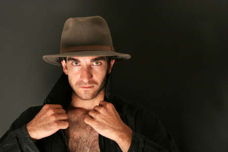 Man in hat and trench coat photo