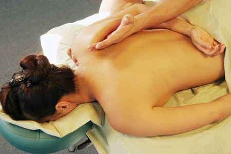 deeptissue: Woman getting a back massage
