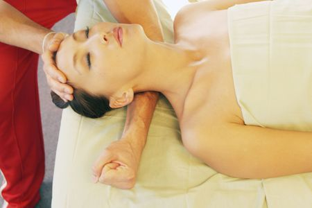 deeptissue: Woman getting a massage Stock Photo