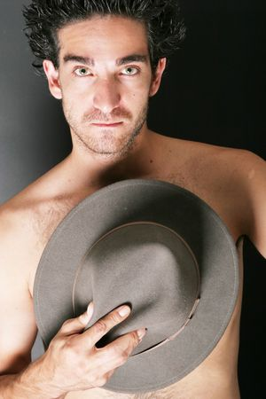 courtesy: Man holding a cowboy hat Stock Photo