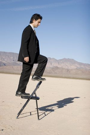 Businessman climbing up the corporate ladder photo