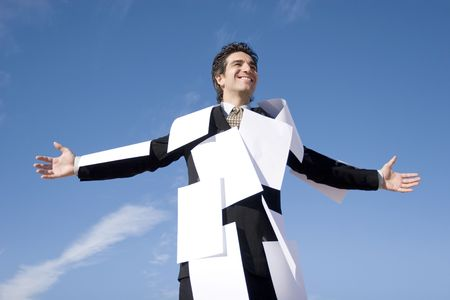 Businessman covered with white papers Stock Photo - 2065051