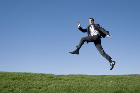 Businessman jumping in the air Stock Photo - 2065079