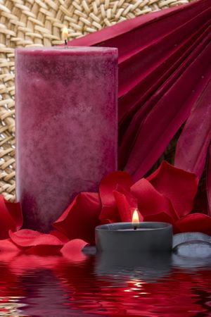 Spa candle and red rose petals photo