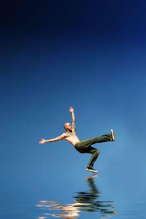 Man about to fall backwards 版權商用圖片