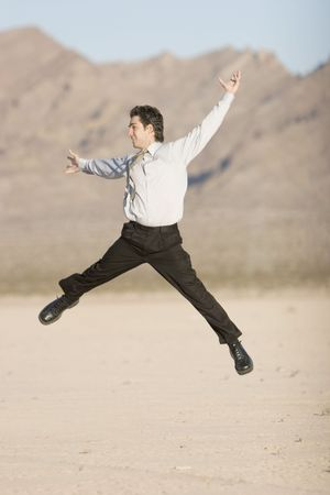 Happy businessman jumping in air photo