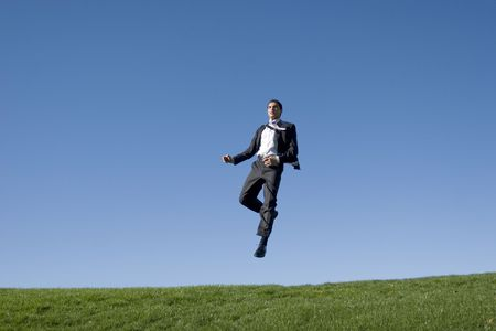 Businessman jumping in the air Stock Photo - 2074480