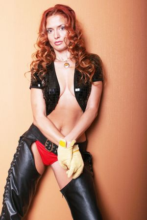 Sexy woman in leather chaps Stock Photo - 2074673