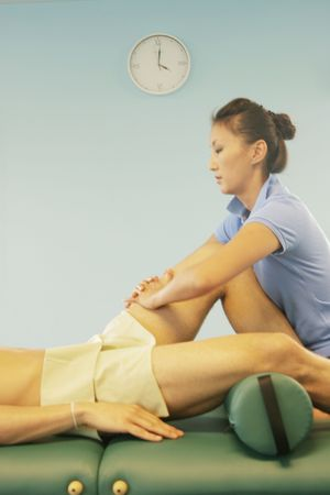 deeptissue: Massage therapist massaging the legs