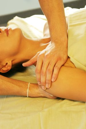 deeptissue: Woman getting massage at the massage parlor Stock Photo