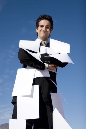 Businessman covered with white papers photo
