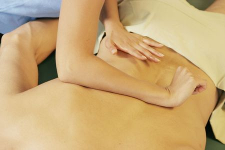 deeptissue: Massage therapist giving back massage