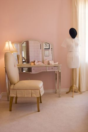 designer chair: Mannequin in the pink room Stock Photo