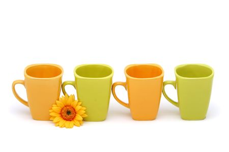 Colorful coffee cups on white background photo