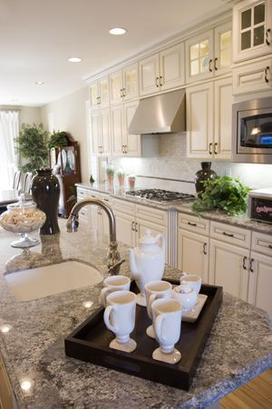 Modern kitchen with granite countertops photo