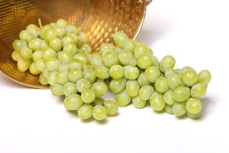 Green grapes in metal bucket photo