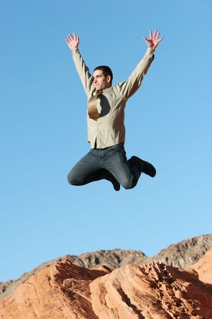 Ecstatic businessman jumping in the air Imagens