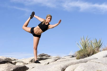 Young woman doing yoga outdoors Stock Photo - 2120594