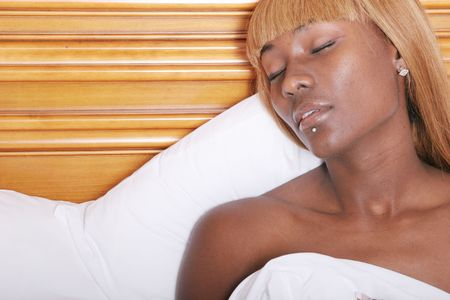 Black woman relaxing in spa photo